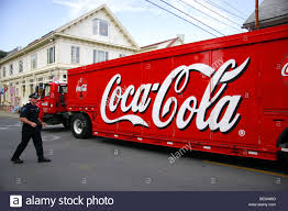 coca cola truck passing a police officer in provincetown cape cod