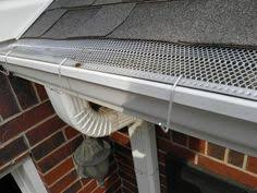 a up using out brown hooks for gutters with mesh