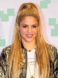 what color is shakira s hair 2015 shakira red hair perro fiel music video instagram