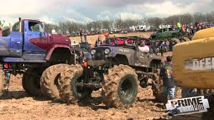 monster trucks racing in mud mega truck mud truck races youtube