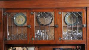 kitchen cabinet doors with glass panels how to install glass in kitchen cabinet doors angi