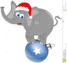 elephant with christmas hat on big decorated ball royalty free
