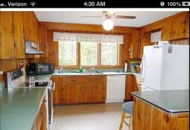 adding wallpaper or paint to kitchen wall with knotty pine