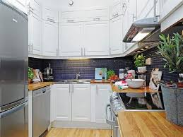 kitchen kitchen renovation wooden laminating flooring in modern kitchen renovation wooden laminating flooring in modern home scandinavian kitchen design ideas with white cabinetry with hardwood countertop also black