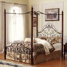 bedroom wooden queen size canopy bed with maroon and white