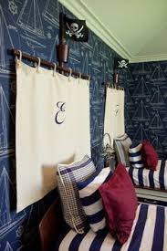 themed headboards make a monogrammed headboard using canvas for a pirate or nautical