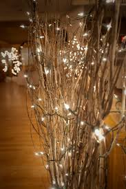 christmas branches with lights sparkly lights in branches attach to poles and as centerpieces