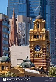 city backdrop clock tower of flinders railway station with city backdrop