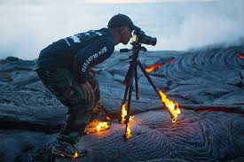 photographer gets so close to lava that his shoes and tripod catch