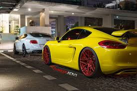 porsche yellow yellow cayman s looking jaunty on matte red custom wheels