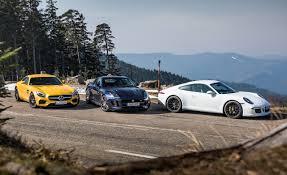 nissan gtr vs jaguar xkr s 2016 jaguar f type r coupe vs 2016 mercedes amg gt s 2015