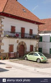 volkswagen new beetle parked in front of a traditional spanish