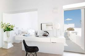 relaxing all white interior room of grace santorini hotel with
