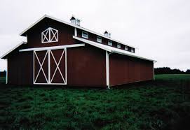 Red Barn Doors by This Monitor Style Barn Has Second Story Windows Cupolas And