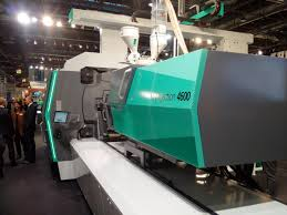 plastic injection molding machines in operation making customer