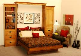 brown wooden couch of brown pattern bed and pillows plus brown