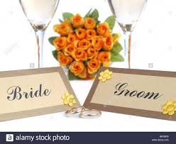 and groom cards and groom name cards wedding rings two white wine glasses