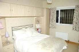 overhead bed storage overhead bedroom cupboards overhead bedroom storage white ikea bed