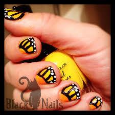yellow monarch butterfly nail art black cat nails