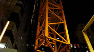 liebherr ltm 1250 taking down tower crane at night youtube