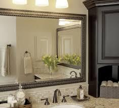 elegant bathroom light fixtures over large vanity mirror elegant