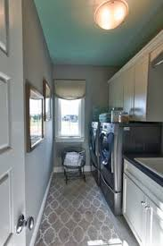 long narrow laundry room lots of counter space wood look ceramic