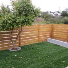 Modern Backyard Fence by Modern Horizontal Fence With Stacked Boards Outside U0026 Exterior