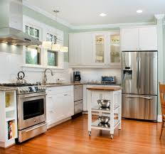 white kitchen cabinets wood floors black counter others
