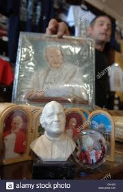 pope souvenirs dpa faithfuls buy souvenirs of pope paul ii at a booth