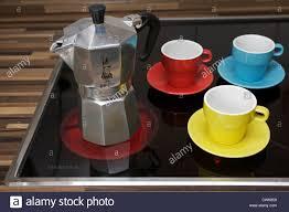 espresso maker electric bialetti moka express coffee pot on electric hob stock photo