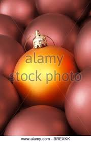 pink and purple christmas baubles close up stock photo royalty