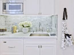 Backsplash With White Kitchen Cabinets White Granite Countertop Metal Sink And Faucet Grey Stone Pattenr