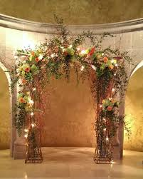 wedding arches ireland our iron arch with curly willow lights and floral in coral green