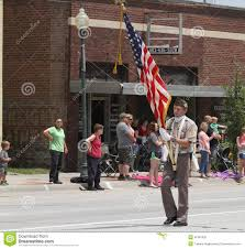 American Flag Watches Color Guard In Parade In Small Town America Editorial Photo