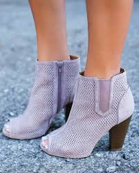 We Are In Love by We Are In Love With Our Fia Booties A Perforated Sleek Stacked