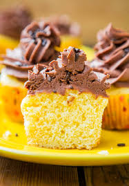 classic yellow cupcakes with chocolate buttercream frosting from
