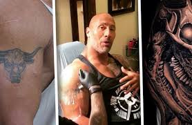 the rock u201cevolves u201d his infamous bull tattoo