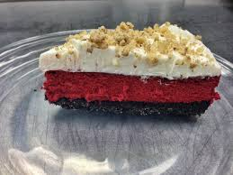 red velvet cheesecake with oreo crumb crust cream cheese frosting