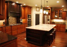 quartz countertops kitchens with cherry cabinets lighting flooring