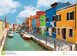 colorful houses by the water canal at the island burano near