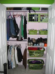 white wooden closet with space for hanging clothes and shoes with