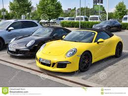 yellow porsche 911 black and yellow porsche 911 carrera 4 gts editorial image image