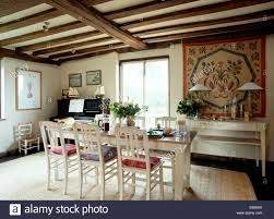 Country Dining Room by Cream Painted Chairs And Table In Beamed Country Dining Room With