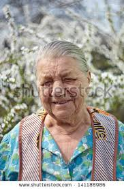 elderly woman clothes smiling elderly woman working clothes against stock photo