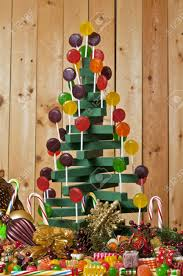 craft wooden lollipop tree surrounded by a cornucopia of christmas