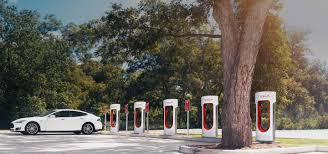 tesla superchargers and graphene batteries push evs