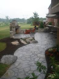 Average Price For Concrete Patio Carved Concrete Patio And Outside Fireplace With Seating Wall