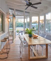 beach home decor archives interior decor a screened in porch with an exit to the outdoors and a firepit offer ideal entertaining spaces in the lowcountry