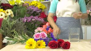 Arranging Roses In Vase Dolly Shot Of Florist Woman Finished To Arranging Flowers In A