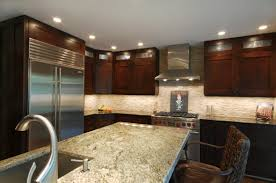 traditional kitchen design with black granite countertop also